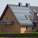 home-with-solar-panels-and-yellow-dandelion-PNH9SWG-1-1.jpg